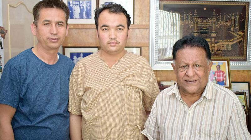 Patient Ahmad Ulla Poya flanked by his uncle Mohammed Poya and Dr K.M.Cherian