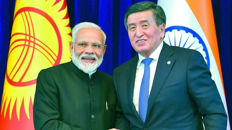 Prime Minister Narendra Modi and Kyrgyz President Sooronbai Jeenbekov at the end of a joint press conference in Bishkek on Friday.  (AFP)