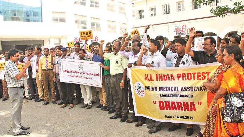 Doctors from Indian Medical Association (IMA) and Tamil Nadu Government Doctors Association stage a dharna in front of the Coimbatore government hospital to protest against the assault of a junior doctor in Kolkata.  (DC)