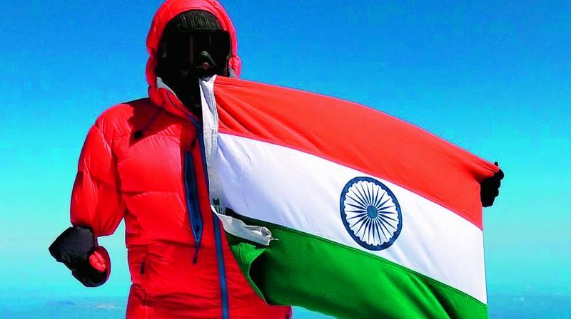 Proud moment: Shekar Goud holding the Indian Flag after scaling Mount Elbrus.