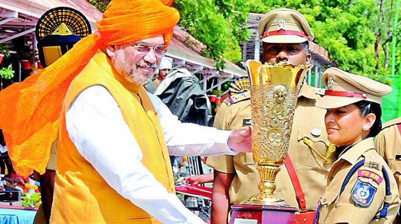 Home minister Amit Shah presents a memento to an IPS probationer Richa Tomar in the city on Saturday.  (Photo: DC)