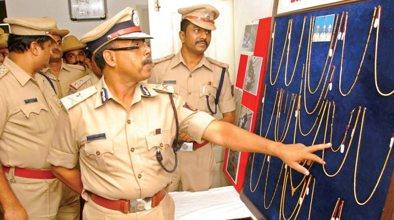 Additional Police Commissioner B.K. Singh inspects the jewelry items seized by Jayanagar police in Bengaluru on Monday (Photo: DC)