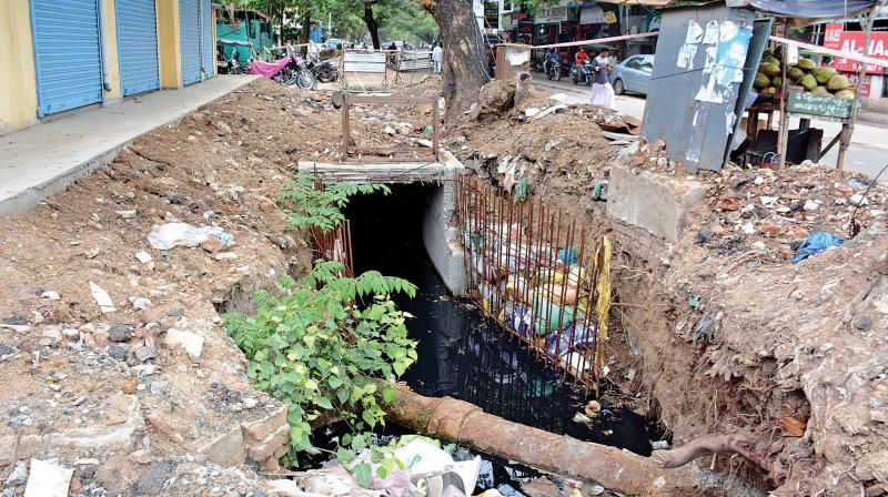 Trenches dug up for storm water drainage posing threats to public and motorists in Ayanavaram. (Photo:DC)