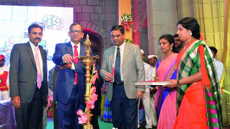 Justice N.V. Ramana lighting the lamp to mark centenary year celebrations of the Telangana High Court building on Saturday.