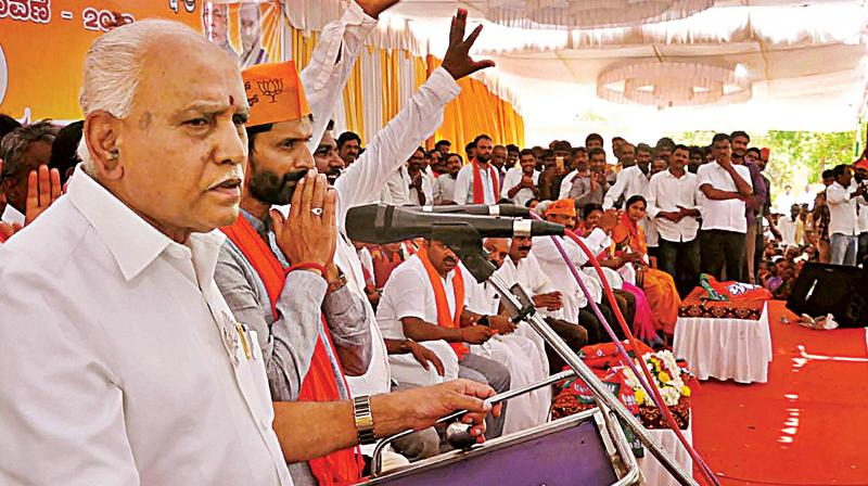 State BJP president B.S. Yeddyurappa campaigns for party candidate C.T. Ravi at Sakharayapatna in Chikkamagaluru district on Thursday.