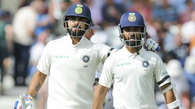 Virat Kohli and Ajinkya Rahane will look to deny Australia any more success after Australia managed to scalp three wickets on Day two of the second Test. (Photo: AP)