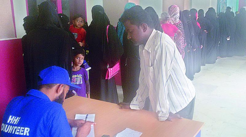 Scores of women waiting outside the consulting room of the Community Centre in Barkas.  (Photo:DC)