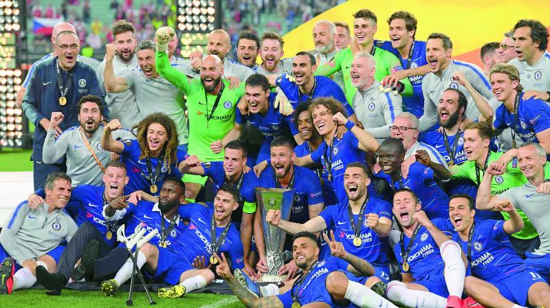 (Top) Chelsea's players celebrate with the trophy after winning the UEFA Europa League final against Arsenal FC at the Baku Olympic Stadium in Baku, Azerbaijian on Thursday. (Left) Chelsea's midfielder Eden Hazard with the trophy. (Photo: AFP)