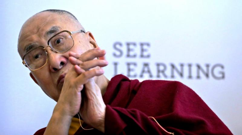 Tibetan spiritual leader the Dalai Lama listening to a question during a press conference in New Delhi. (Photo: AP)