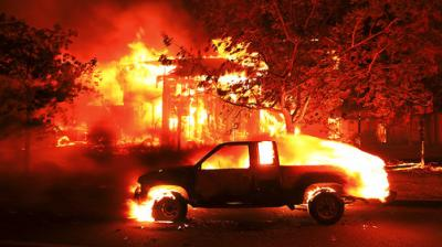 Firefighters battled wildfires in California's wine region on Tuesday as the death toll rose to 15 and thousands were left homeless in neighborhoods reduced to ashes.