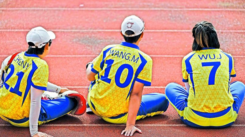 Chinese players watch the action as they take on Hong Kong in Shanghai. Followers says the sport is gradually growing in China, where there is thought to be only one grass cricket pitch for a population of 1.4 billion. (Photo: AFP)