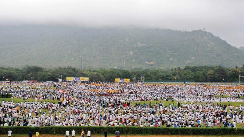 More than 60,000 people performed yoga in Mysuru on Thursday to mark International Yoga Day (Photo: KPN)