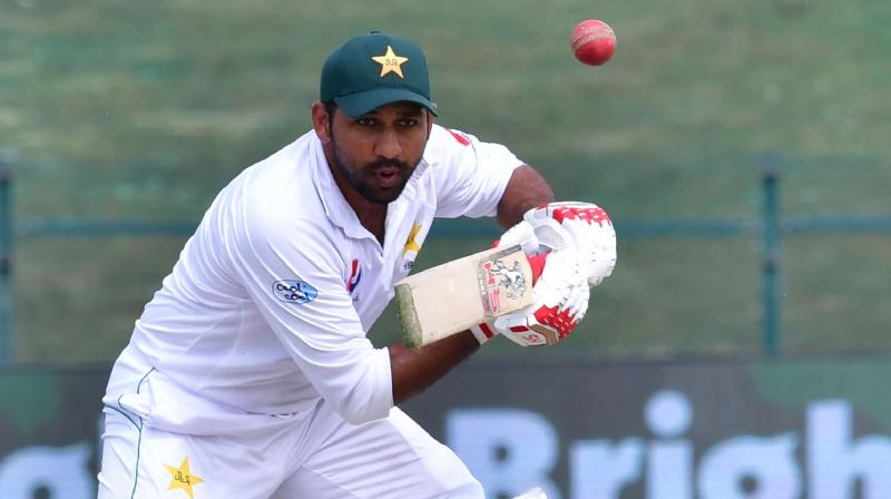 Pakistan captain Sarfraz Ahmed has been taken to hospital and did not take the field on day four of the second Test against Australia after taking a blow to the helmet, while visiting batsman Usman Khawaja was ruled out with a knee injury. (Photo: AFP)