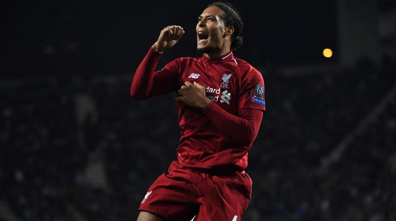 Van Dijk also won the PFA's Premier League Player of the Year award. (Photo: AFP)