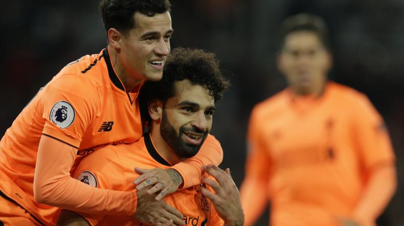 Injured Liverpool playmakers Philippe Coutinho and Mohamed Salah are doubtful for Friday's FA Cup match against Merseyside rivals Everton after missing their side's 2-1 Premier League win over Burnley on Monday, manager Juergen Klopp has said.(Photo: AP)