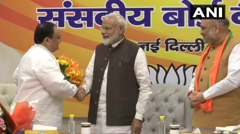 Prime Minister Narendra Modi and other senior BJP leaders presented bouquets to JP Nadda at the BJP headquarters. (Photo: ANI)