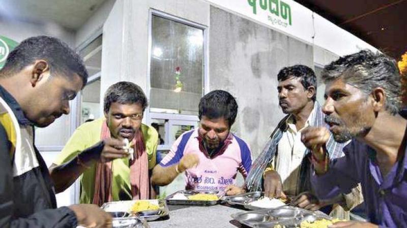 People eat at an Indira Canteen in Bengaluru