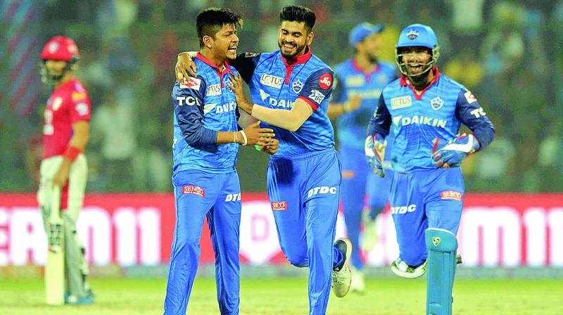 Delhi leg-spinner Sandeep Lamichhane (left) and captain Shreyas Iyer celebrate a Kings XI wicket. (Photo: Pritam Bandyopadhyay)