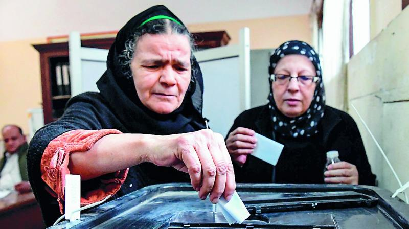 Elderly Egyptian women cast their vote at a polling station at a school in Cairo's northern neighbourhood of Shubra, on the first day of a three-day poll, on Saturday.  (Photo: AFP)