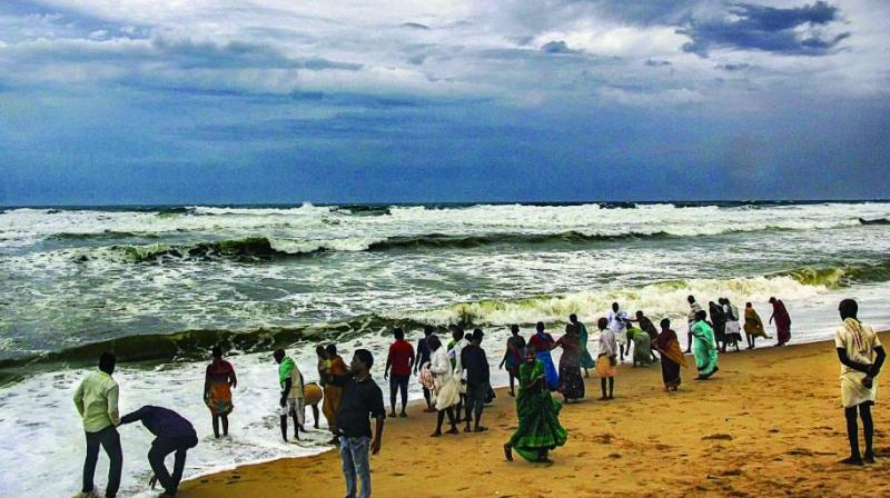 Villagers at the beach as dark clouds hover above the sea ahead of cyclone Fani in Puri on Thursday. (Photo: PTI)