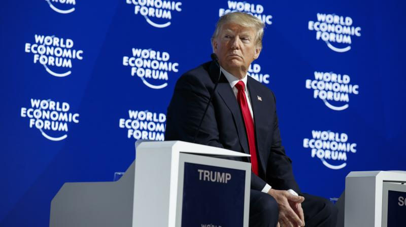 US President Donald Trump listens as he is introduced to deliver a speech to the World Economic Forum. (Photo: AP)