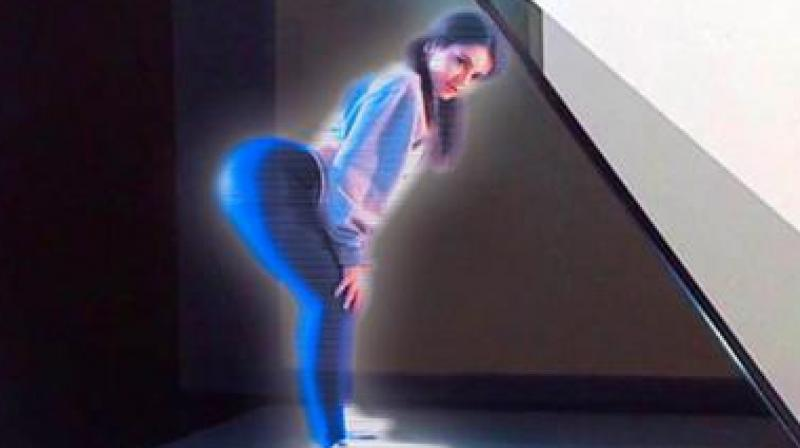 A Japanese company has even created a hologram wife that does everything a real wife would do. (Photo: Youtube)