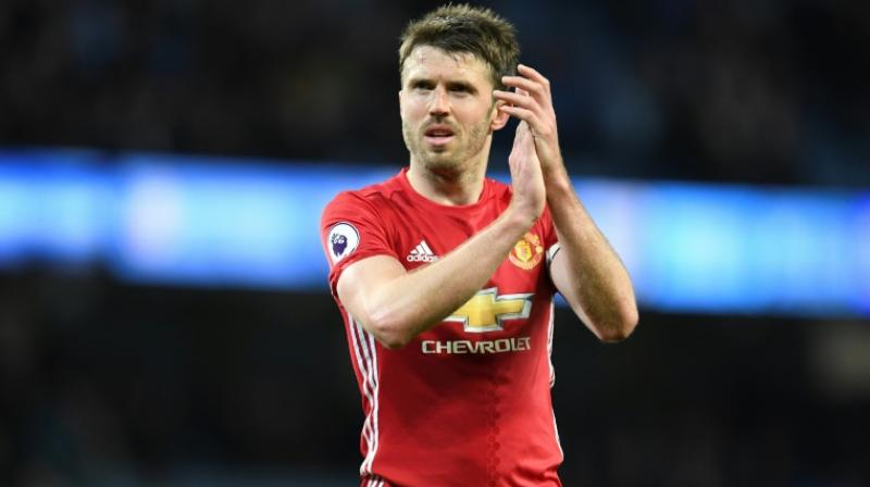 Mourinho believes Carrick, who is back in full training, will return to the pitch over the second half of the season. (Photo: AFP)