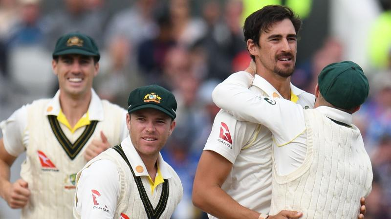 Mitchell Starc celebrates the fall of wickets with his teammates. (Photo:AFP)