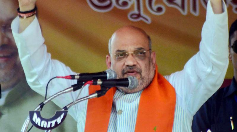 BJP national chief Amit Shah addresses during a press meet ahead of the third phase of the Lok Sabha elections in Kolkata on Monday. The fate of BJP contestant from Gandhinagar seat will also be decided today.  (PTI)