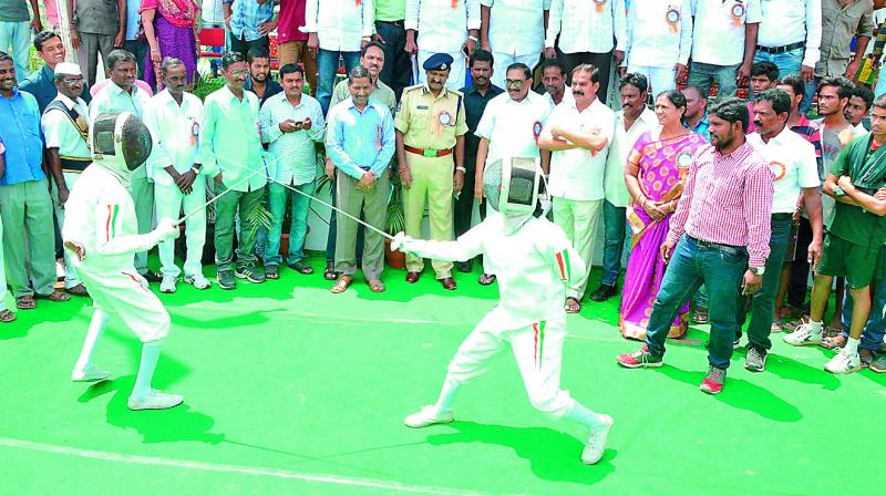 Students fence after inauguration of sports festival in Hanamkonda on Wednesday. (Photo: DC)