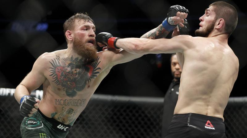 McGregor managed to roll away briefly before Nurmagomedov ended up in a full mount, getting him in a brutal rear-naked chokehold that had McGregor tapping out at 3min 3sec of the round. (Photo: AP)