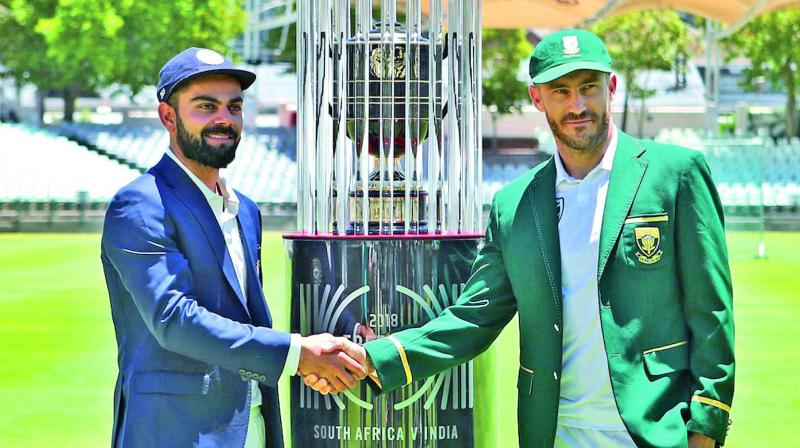 Virat Kohli (left) and Faf du Plessis pose with the Freedom Trophy ahead of their Test series. (Photo: BCCI)