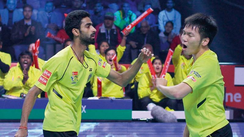 Chennai Smashers' B. Sumeeth Reddy and Lee Yang in action against Ivanov and Sozonov of Delhi Dashers  in their PBL trump match in Lucknow on Wednesday.