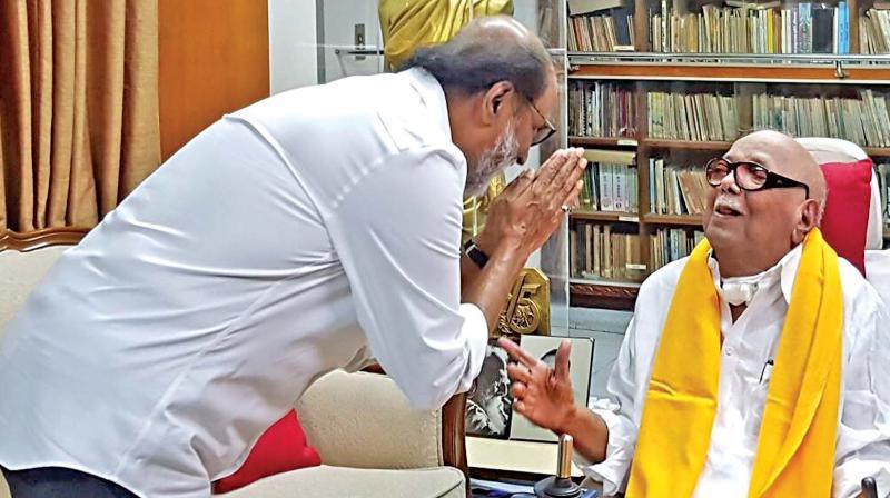 Rajinikanth calls on DMK president M.K. Karunanidhi.