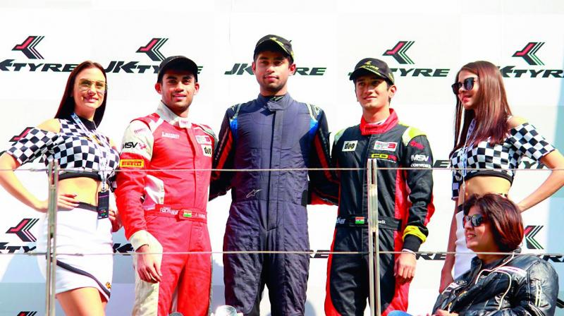 Winner Anindith Reddy celebrates on the podium with Nayan Chatterjee and Akhil Rabindra. (Photo: DC)