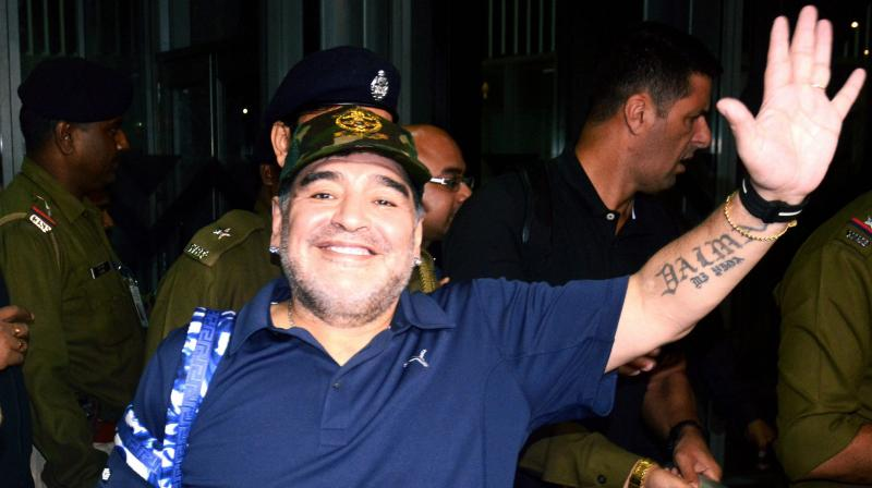 Diego Maradona helps unveil a giant statue of himself