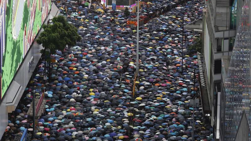 Protesters turned Hong Kong streets into rivers of umbrellas Sunday as they marched from a packed park and filled a major road in Hong Kong, where mass pro-democracy demonstrations have become a regular weekend activity over the summer. (Photo: AP)