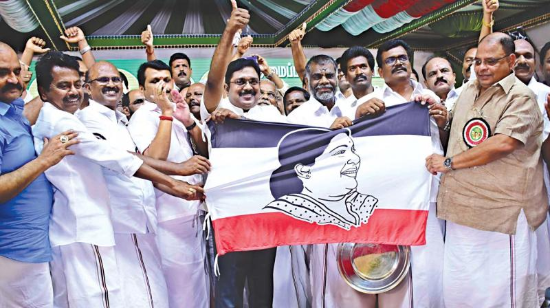 RK Nagar MLA T.T.V. Dhinakaran showing his new party flag in Melur, in Madurai district, on Thursday. (Photo: K. Manikandan)