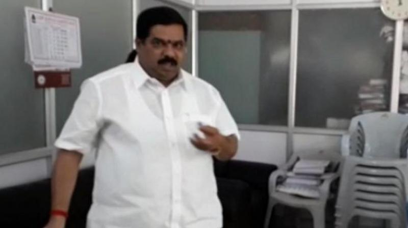 The video posted by local channels show Narayanaswamy splashing petrol from a bottle in the BBMP office at Bengaluru's Horamavu. (Photo: Screengrab)