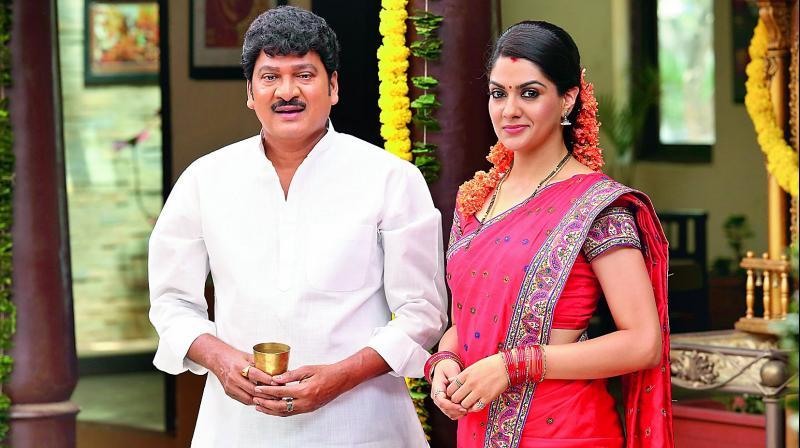 Rajendra Prasad and Sakshi Chaudhary from the film Oo Pe Ku Ha
