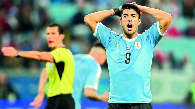 Uruguay's Luis Suarez reacts after missing a chance to score against Japan in Porto Alegre on Thursday. (Photo: AP)