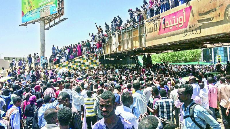 Protesters rally in front of the military headquarters in the capital Khartoum, Sudan, on Monday. Organisers behind the anti-government demonstrations said security forces attempted to break up a sit-in outside the military headquarters. (Photo: AP)