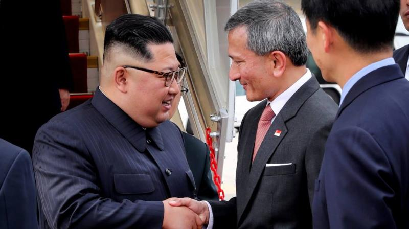 The city-state's foreign minister Vivian Balakrishnan tweeted a picture of himself shaking hands with Kim at Changi Airport. (Photo: @VivianBala/Twitter)