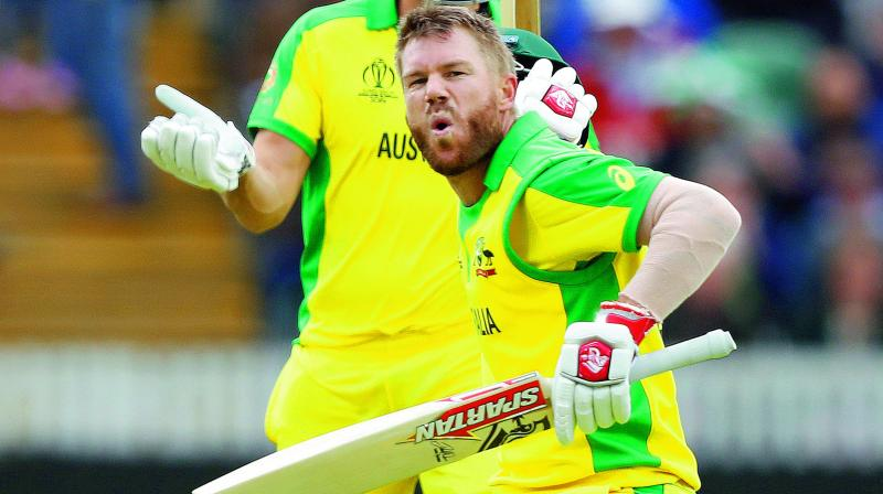 Australian opener David Warner celebrates his century against Pakistan at the County Ground in Taunton on Wednesday. (Photo: AP)