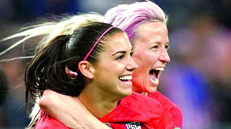 United States forward Alex Morgan (left) and Megan Rapinoe celebrate a goal during the Women's World Cup Group 'F' football match against Thailand at the Auguste-Delaune Stadium in Reims, eastern France, on Wednesday. (Photo: AFP)