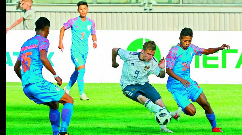A photo released by the Football Union of Russia shows an Indian player (in blue) in action against Russia in the Granatkin Memorial Tournament earlier this month.