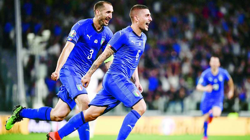 Italy's Marco Verratti (right) celebrates with Giorgio Chiellini after scoring against Bosnia Herzegovina  during the UEFA Euro 2020 qualification match in Turin on Wednesday. (Photo: AFP)