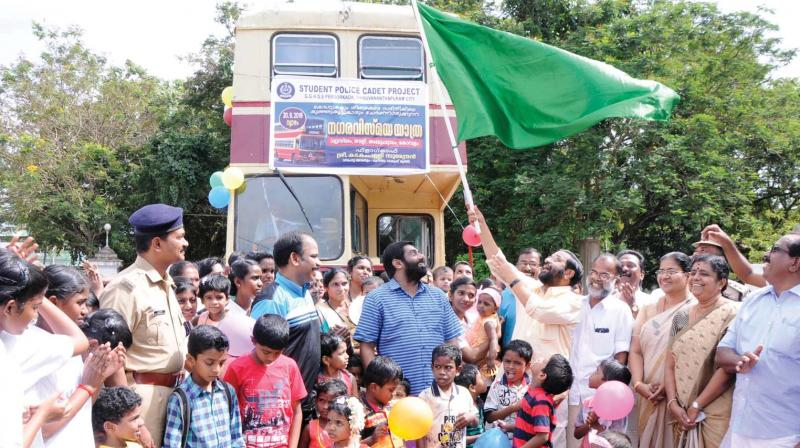 Tourism Minister Kadakampally Surendran  flags off the  double-decker bus ride for children, organised by Student Police Cadet Project and Kerala State Council for Child Welfare  in Thiruvananthapuram on Thursday. (Photo:A.V. Muzafar)