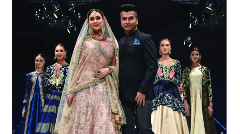 Vikram Phadnis with showstopper  Kareena Kapoor Khan at a fashion show in Doha.