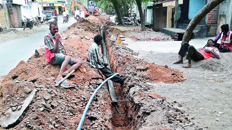 Pipes are being laid for internet cables along with the water pipes under the MB in the Adilabad town. (Photo: DC)